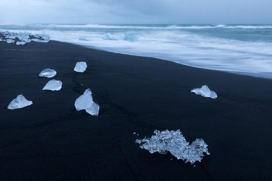 Ice on black sand beach