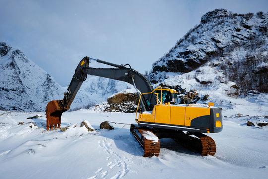 Old excavator in winter