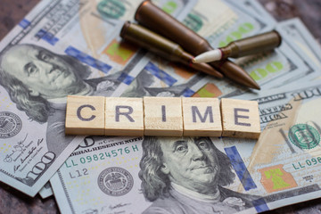 Criminal sign on usa dollars background. Black market, contract killing, robbery, mafia and crime concept.