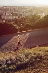 Old man senior jogging sport activity at sunset in Cagliari Sardinia - Italy Saint Michele Hill (Monte San Michele).