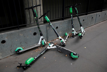 Dock-free electric scooters Lime-S by California-based bicycle sharing service Lime are seen on a sidewalk in Paris