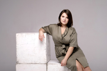 plus size model on gray background