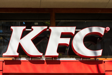 TIMISOARA, ROMANIA - AUGUST 25, 2014: Kentucky Fried Chicken Restaurant Sign. It is a fast food restaurant chain headquartered in United States specialized in chicken products.