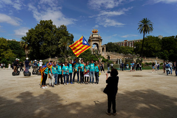 "People pose for a picture as they hold an up ""Estelada"" (Catalan separatist flag) on Catalonia's national day 'La Diada' in Barcelona"