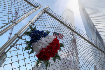 Flowers are seen left near One World Trade Center on the 18th anniversary of the September 11, 2001 attacks in New York