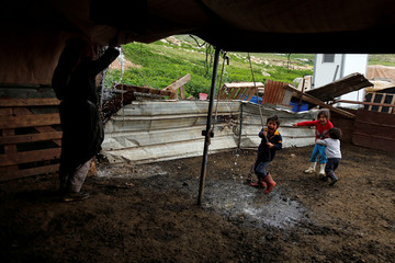 Palestinian children play at their family tent in the Bedouin village of Al-Maleh in Jordan valley in the Israeli-occupied West Bank