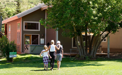 Kelly Pfaff walks back to her house with her children after playing soccer in Park City