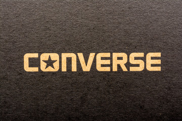 BUCHAREST, ROMANIA - MARCH 16, 2014: All Star Converse Sign On Retro Converse Sneakers Box. Founded in 1908 is an American lifestyle company with a production output of shoes and lifestyle fashion.