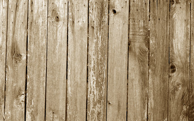 Weathered wooden fence in brown color.