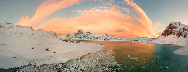 Aerial drone panorama photo. Beautiful sunset over the mountains and sea of the Lofoten Islands. Reine, Norway. Winter landscape with amazing colors. Wall mural
