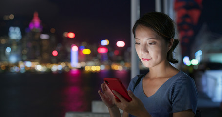 Wall Mural - Woman use of mobile phone in city at night