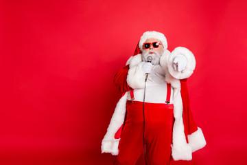 Portrait of fat overweight real pop star hipster santa claus with big abdomen broadcast sing songs wear style stylish trendy eyewear eyeglasses hat headwear isolated over yellow background