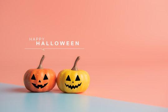 Happy Halloween message, Pumpkin on pastel paper background.