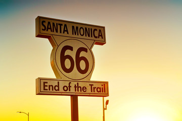 Fotobehang Route 66 Road sign of route 66 as the terminus on Santa Monica beach at sunset.