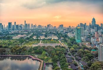 Fototapete - Sunset over Benjakiti park in Bangkok