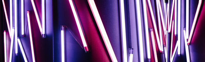 Neon lights. Light colorful blue and red neon lights over dark background