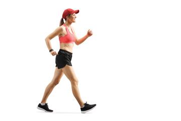 Smiling young female walking in sportswear