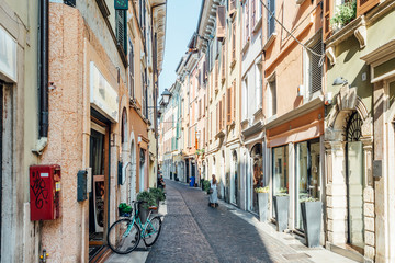 Salo' Lake Garda, Italy - Sunday 1 September 2019: food and buildings in the historic center of Salo'