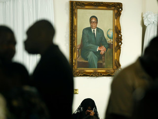 Grace Mugabe sits below a portrait of her late husband, former Zimbabwean President Robert Mugabe