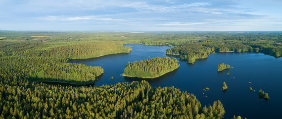 Beautiful lakes and green forest at bright sunrise. Morning in countryside concept. Aerial panorama.