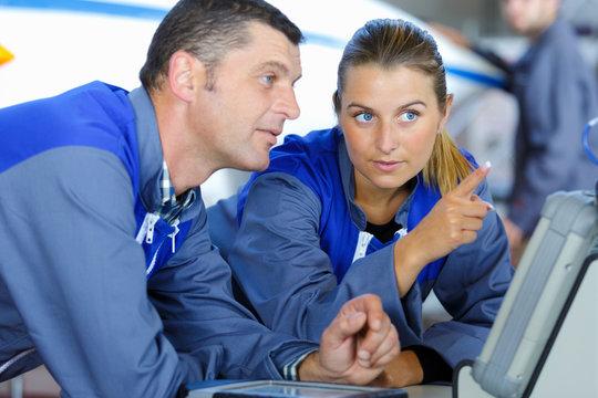 portrait of two modern mechanics chatting
