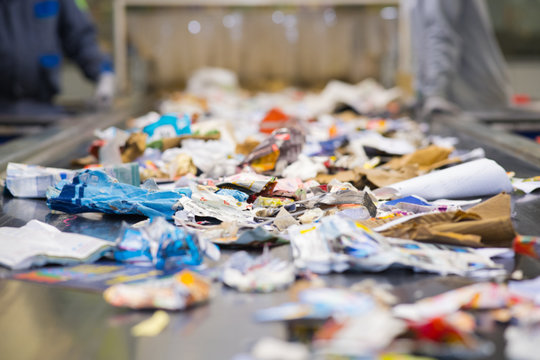 view of waste paper on a conveyor belt