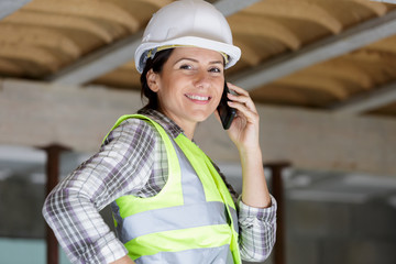 smiling businesswoman builde on the phone