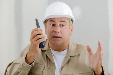 man with a walkie talkie indoors