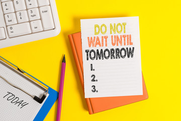 Writing note showing Do Not Wait Until Tomorrow. Business concept for needed to do it right away Urgent Better do now Pile of empty papers with copy space on the table