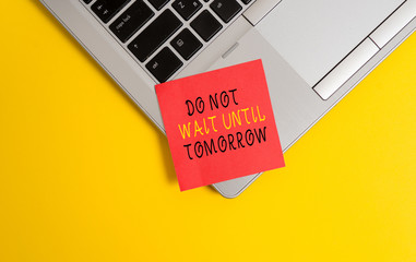 Writing note showing Do Not Wait Until Tomorrow. Business concept for needed to do it right away Urgent Better do now Metallic trendy laptop blank sticky note empty text colored background