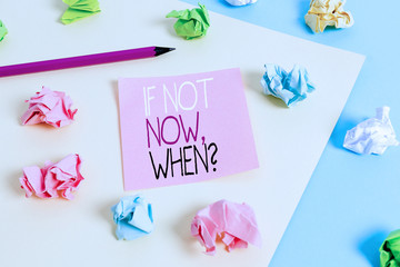 Writing note showing If Not Now When Question. Business concept for start acting from this moment do not hesitate Colored crumpled papers empty reminder blue yellow clothespin