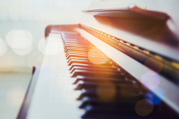 selective and soft focus of piano keys with bokeh light effected