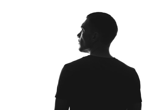 silhouette of man from behind on a white background looks away