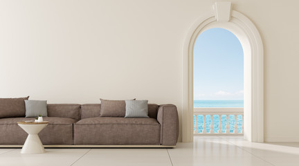 View of living room in mediterranean style with arch window design,Classic details,Room with sofa and side table on sea view background. 3d rendering.