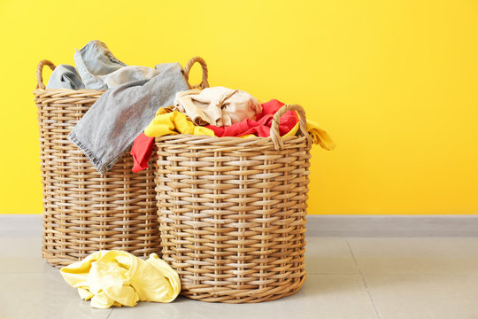 Baskets with dirty laundry on floor