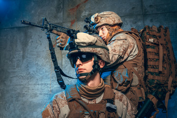 Two well equipped US army commandos armed with assault rifles. Studio shot