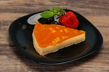 Cheesecake with apricot served strawberry