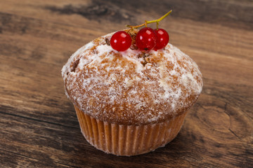 Sweet tasty muffin with red currants