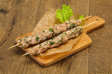 Raw minced pork skewer kebab for grill