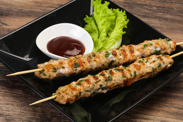 Minced pork skewer kebab with sauce