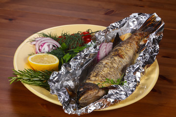 Stuffed baked pike with lemon