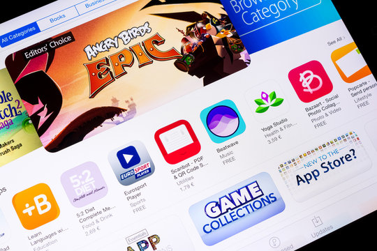 BUCHAREST, ROMANIA - JUNE 16, 2014: Apple Application Store On Apple iPad Air. In 2008, Apple launched the App Store introducing third-party app development and distribution.