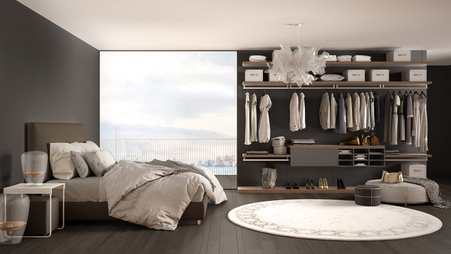 Luxury white and gray modern bedroom with double bed and walk-in closet, parquet floor, panoramic window with winter panorama, carpet, pouf, minimal architecture interior design