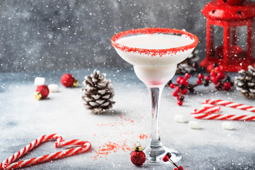 Snow daiquiri, Christmas or New Year alcoholic cocktail with rum and cream with red decor in festive setting, copy space