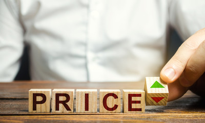 A man changes the position of a block with symbols of growth and decline near the word Price. Price regulator, supply-demand balance, market laws. Economics and free commerce. Planned Economy.