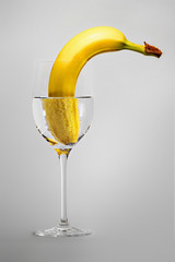 banana in a wineglass with water