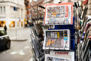 PARIS, FRANCE - OCT 28, 2017: Details of  Liberation French newspaper with news from Spain about the Catalonia Referendum and protests in Barcelona - kiosk stand in city