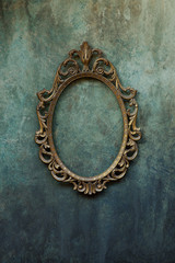 Metal oval frame on a wall