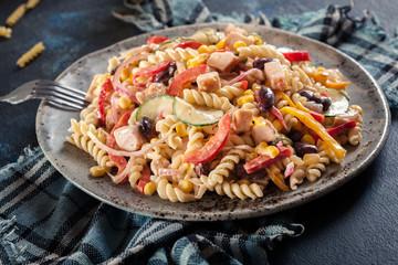 Fusilli pasta salad with smoked turkey