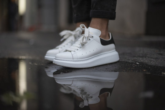 Milan, Italy - May 11, 2019: Man wearing a pair of Alexander McQueen sneakers in the street
